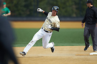Bruce Steel (17) of the Wake Forest Demon Deacons rounds second base during the game against the Notre Dame Fighting Irish at David F. Couch Ballpark on March 10, 2019 in  Winston-Salem, North Carolina. The Demon Deacons defeated the Fighting Irish 7-4 in game one of a double-header.  (Brian Westerholt/Four Seam Images)