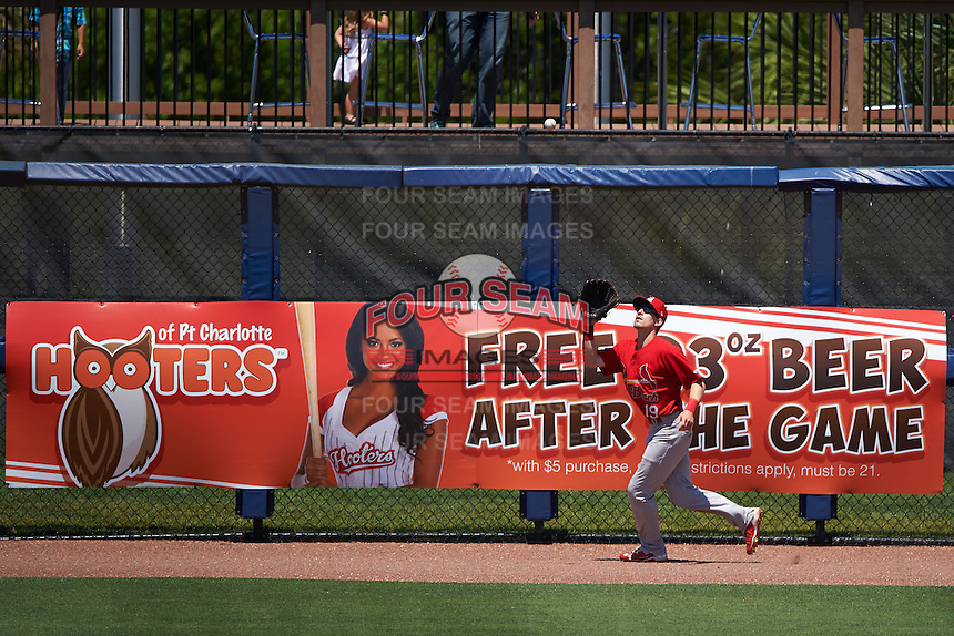 Palm Beach Cardinals left fielder Michael Pritchard (19) catches a fly ball in front of a Hooters advertisement during a game against the Charlotte Stone Crabs on April 10, 2016 at Charlotte Sports Park in Port Charlotte, Florida.  Palm Beach defeated Charlotte 4-1.  (Mike Janes/Four Seam Images)
