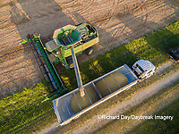 63801-08713 Soybean Harvest, unloading soybeans into semi-truck John Deere combine- aerial - Marion Co. IL