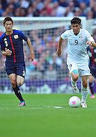 August 07, 2012..Mexico's Oribe Peralta and Japan's Takahiro Ohgihara in action during Semi Final match at the Wembley Stadium on day eleven in Wembley, England. Mexico defeat Japan 3-1 to reach Men's Finals of the 2012 London Olympics...