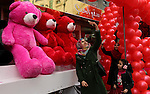 A Palestinian woman takes a selfie with red teddy bears outside a shop on Valentine's day in Gaza city on February 14, 2017. Valentine's Day is increasingly popular in the region as people have taken up the custom of giving flowers, cards, chocolates and gifts to sweethearts to celebrate the occasion. Photo by Ashraf Amra