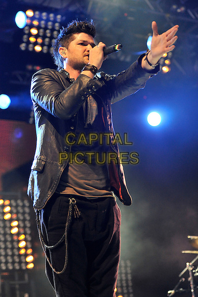 THE SCRIPT - Danny O'Donoghue.Performing live at Radio 1's Big Weekend, Carlisle, England, UK, .May 15th 2011..festival music on stage concert gig half length chains microphone singing black grey gray  leather shirt jacket hand .CAP/MAR.© Martin Harris/Capital Pictures.