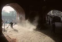 A man sweeps the entrance to the Wazir Khan Mosque in Lahore, Pakistan in 1996. The mosque was built around 1634–1635 during the reign of the Mughal Emperor Shah Jehan.