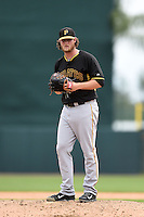 Pitcher Gerrit Cole (45) of the Pittsburgh Pirates during a spring training game against the Baltimore Orioles on March 23, 2014 at McKechnie Field in Bradenton, Florida.  Baltimore and Pittsburgh played to a 7-7 tie.  (Mike Janes/Four Seam Images)