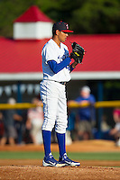 Burlington Royals starting pitcher Julio Pinto (47) looks to his catcher for the sign against the Danville Braves at Burlington Athletic Park on July 5, 2014 in Burlington, North Carolina.  The Royals defeated the Braves 5-4.  (Brian Westerholt/Four Seam Images)