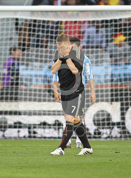 03.07.2010, CAPE TOWN, SOUTH AFRICA, im Bild .Bastian Schweinsteiger of Germany reacts after missing with his shot during the Quarter Final, Match 59 of the 2010 FIFA World Cup, Argentina vs Germany held at the Cape Town Stadium.Foto ©  nph /  Kokenge