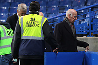 A Chelsea safety steward opens a gate for Bobby Charlton to depart the Stadium during Chelsea vs Manchester United, Premier League Football at Stamford Bridge on 5th November 2017