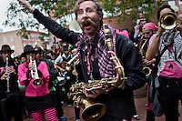 Members of Brass Liberation Orchestra of Oakland, California, perform in Harvard Square in Cambridge, Massachusetts, USA, during the HONK! Festival.  The HONK! Festival is an annual gathering of activist street marching bands that involves performances, a parade between Davis Square in Somerville and Harvard Square in Cambridge, and an academic symposium about street music.