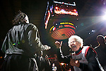 12/26/11--Sally Williams of Hermiston who recently turned 80-years-old and has been a Trail Blazers fan for 40 years, high-fives Portland's Gerald Wallace as the starters are introduced before the home-opener with the Philadelphia 76ers..Photo by Jaime Valdez. .........................................