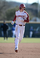 Arkansas right fielder Heston Kjerstad rounds the bases Friday, Feb. 14, 2020, after hitting a home run over the right field wall during the fifth inning against Eastern Illinois at Baum-Walker Stadium in Fayetteville. Visit nwaonline.com/200214Daily/ for today's photo gallery.<br /> (NWA Democrat-Gazette/Andy Shupe)