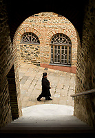 Mount Athos - The Holy Mountain.<br /> A monk walks to prayer.<br /> Photographer: Rick Findler