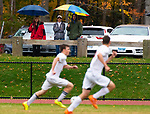 THOMASTON,  CT-101619JS11-Fans stand under umbrellas as the heavy rains moved into the area during Thomaston's boys soccer game against Terryville  Wednesday at Nystrom Park in Thomaston.<br /> Jim Shannon Republican-American