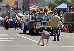 One of the Youngsters who were challenged to get to the variety of candy and other goodies thrown into the street by marchers as the Independence Day Parade marched along Main Street in Saugerties, NY on Thursday, July 4, 2013. Photo by Jim Peppler. Copyright Jim Peppler 2013 all rights reserved.