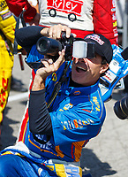 Sep 3, 2017; Clermont, IN, USA; NHRA funny car driver Ron Capps takes photos with a camera during qualifying for the US Nationals at Lucas Oil Raceway. Mandatory Credit: Mark J. Rebilas-USA TODAY Sports