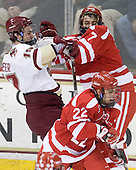 Chris Kreider (BC - 19) and Max Nicastro (BU - 7) battle, Ross Gaudet (BU - 22) - The Boston College Eagles defeated the visiting Boston University Terriers 5-2 on Saturday, December 4, 2010, at Conte Forum in Chestnut Hill, Massachusetts.