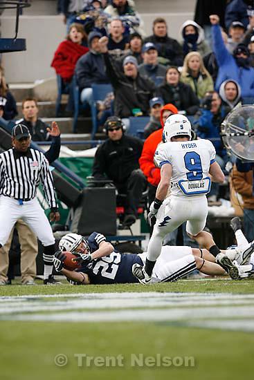 BYU's Luke Ashworth (29) scores a touchdown ahead of Air Force's Luke Hyder (9). BYU vs. Air Force college football Saturday, November 21 2009.