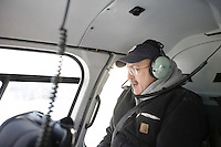 John Lippert in helicopter over Ft McMurray Oil Sand Developments