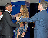 Chrissy Teigen greets Seattle Seahawks quarterback Russell Wilson as they arrive on the Red Carpet for the 2015 White House Correspondents Association Annual Dinner at the Washington Hilton Hotel on Saturday, April 25, 2015.  Publisher Jason Binn is at right.<br /> Credit: Ron Sachs / CNP