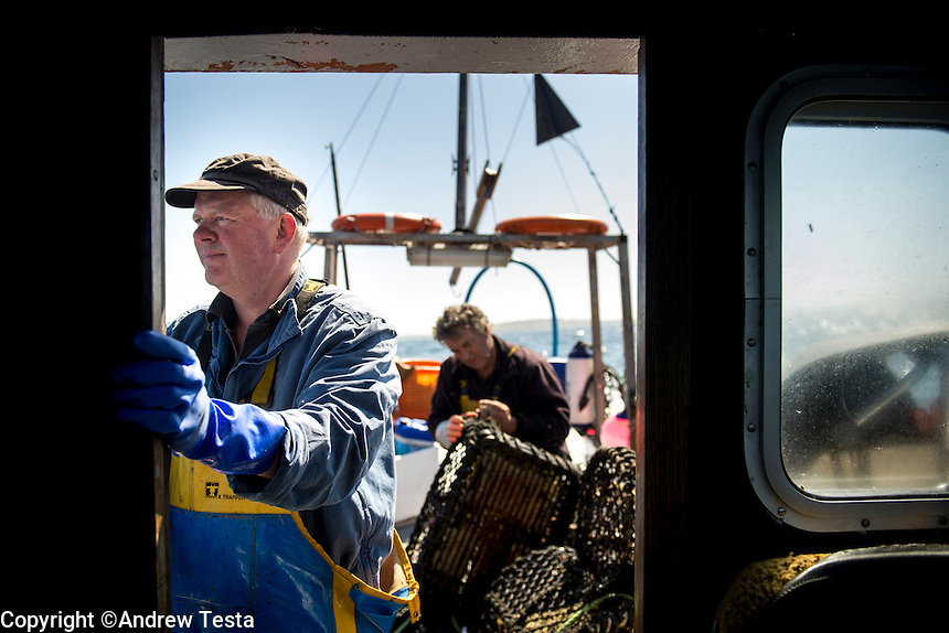 UK. St Mary's. 31st May 2013<br /> Robert Francis fishing for Lobster and Crab. Whatever he catches is served to the guests at the Star Castle Hotel, which he owns.<br /> &copy;Andrew Testa for the New York Times