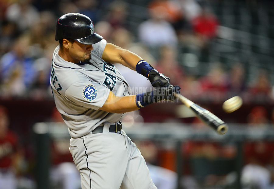 Jun. 20, 2012; Phoenix, AZ, USA; Seattle Mariners outfielder Franklin Gutierrez hits a three run home run in the eighth inning against the Arizona Diamondbacks at Chase Field.  Mandatory Credit: Mark J. Rebilas-