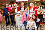 Garvey's Christmas Food Fair: Sampling the food at Garvey's Christmas Food Fair at their store in Listowel on Thursday last were Holly Laurence, William McKenna, Marie Lavery, Santa Claus, Marie Kearney & Denise, Dylan & Evie Tracey with Mrs. Claus.