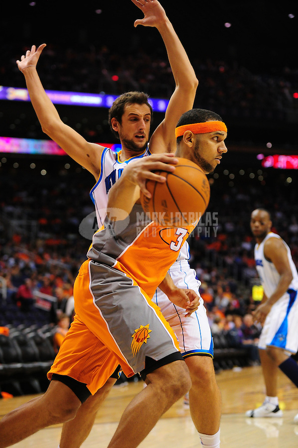 Mar. 25, 2011; Phoenix, AZ, USA; Phoenix Suns forward Jared Dudley (near) controls the ball under pressure from New Orleans Hornets guard Marco Belinelli at the US Airways Center. The Hornets defeated the Suns 106-100. Mandatory Credit: Mark J. Rebilas-USA TODAY Sports