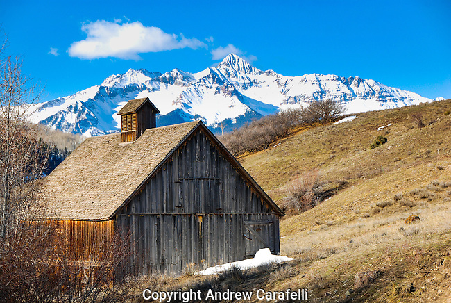 An old barn sits quite near Telluride, Colorado as 14,000 Wilson Peak rises in the background.
