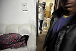 African asylum-seekers prepare for a night sleep at their temporary shelter in southern Tel Aviv, Israel.