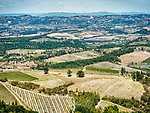 Rolling hills, farms and vineyards surrounding San Gimignano, Siena-Tuscano, Italy