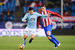 Facundo Roncaglia (l) of RC Celta de Vigo competes for the ball with Fernando Torres of Atletico de Madrid during their La Liga match between Atletico de Madrid and RC Celta de Vigo at the Vicente Calderón Stadium on 12 February 2017 in Madrid, Spain. Photo by Diego Gonzalez Souto / Power Sport Images