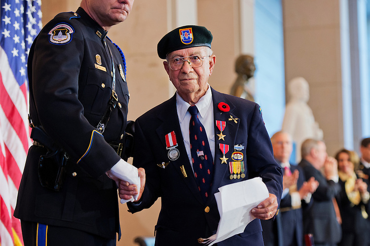 UNITED STATES - FEBRUARY 03: Eugene Gutierrez, 93, of Texas, a member of the 1st Special Service Force, attends a Congressional Gold Medal ceremony in the Capitol Visitor Center's Emancipation Hall to honor the 1st Special Service Force members who fought in Europe during World War II, February 3, 2015. Also known as the Devil's Brigade, the force was a joint World War II American-Canadian commando unit that trained at Fort Harrison in Montana. (Photo By Tom Williams/CQ Roll Call)