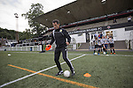 Former Scotland internationalist and club ambassador John Collins, coaching youngsters on the pitch friar to Gala Fairydean Rovers' first home match in the Scottish Lowland Football League against Edinburgh City at Netherdale in Galashiels. Gala were formed in 2013 by an a re-amalgamation of Gala Fairydean and Gala Rovers, the two clubs having separated in 1908 and their ground in the Scottish Borders had one of only two stands designated as listed football stands in Scotland. The match ended in a 3-3 draw watched by 378 spectators.