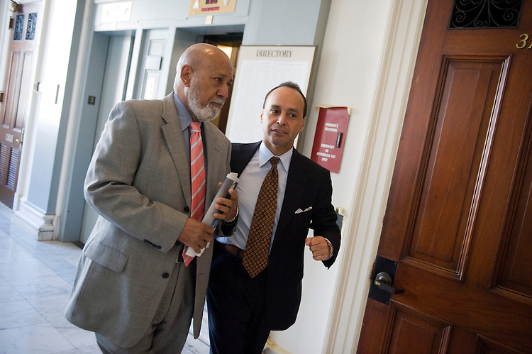 UNITED STATES - NOVEMBER 16: Reps. Alcee Hastings, D-Fla., left, and Luis Gutierrez, D-Ill., make their way to the House Democratic leadership elections. (Photo By Tom Williams/Roll Call)