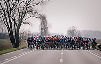 The peloton taking it easy after the breakaway group is allowed to go free<br /> <br /> 81st Gent-Wevelgem in Flanders Fields (1.UWT)<br /> Deinze &gt; Wevelgem (251km)