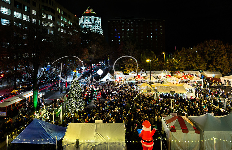 Photography of the Charlotte Uptown tree lighting at the corner of 7th and Tryon Street in at Christmas Village in Charlotte, North Carolina. <br /> <br /> Charlotte Photographer - PatrickSchneiderPhoto.com