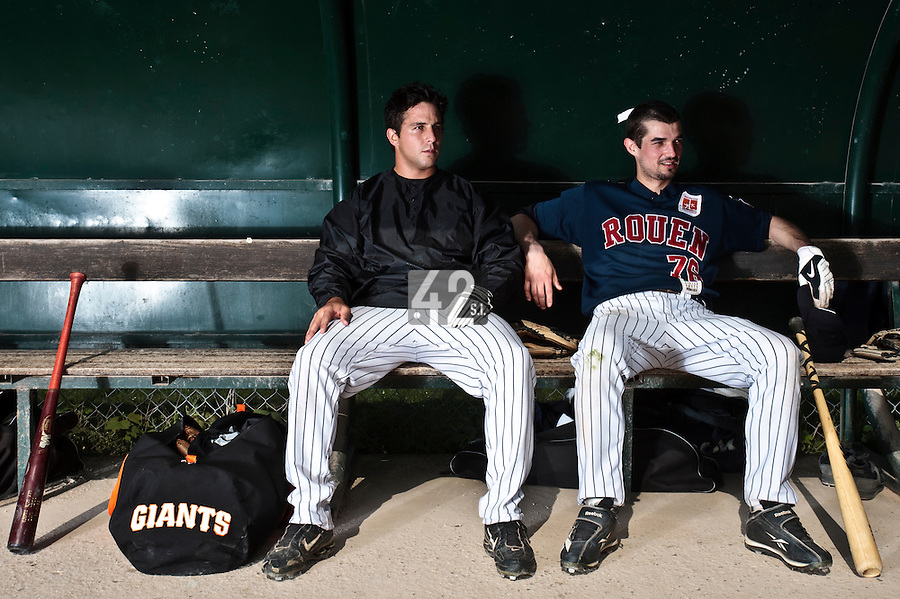 25 April 2010: Mark Terrana of Rouen sits next to Mathieu Crescent in the dugout prior to game 2/week 3 of the French Elite season won 12-0 by Rouen over the PUC, at the Pershing Stadium in Vincennes, near Paris, France.