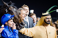 DUBAI, UNITED ARAB EMIRATES - MARCH 25: Shiekh Mohammed bin Rashid Al Maktoum pets Jack Hobbs #2 that was ridden by William Buick, in the winners circle after winning the Longines Dubai Shemma Classic at Meydan Racecourse during Dubai World Cup Day on March 25, 2017 in Dubai, United Arab Emirates. (Photo by Douglas DeFelice/Eclipse Sportswire/Getty Images)