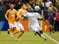 LA Galaxy forward Edson Buddle slides by Houston Dynamo's Bobby Boswelll during the Western Conference Final. The LA Galaxy defeated the Houston Dynamo 2-1 to win the MLS Western Conference Final at Home Depot Center stadium in Carson, California on Friday November 13, 2009.....