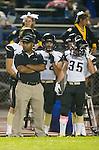 Lawndale, CA 10/18/13 - Lee Webb (Peninsula Coach) and Garrett Nelsen (Peninsula #35) in action during the Peninsula vs Leuzinger Varsity football game at Leuzinger High School.