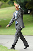 United States President Barack Obama waves to the press as he departs the South Lawn of the White House en route to Martha's Vineyard for a ten day vacation on Thursday, August 18, 2011 in Washington..Credit: Roger L. Wollenberg / Pool via CNP