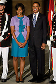 Washington, DC - July 24, 2009 -- United States President Barack Obama, left, and First Lady Michelle Obama, right, pose for a photo at the end of the Evening Parade at the Washington Marine Barracks on Friday, July 24, 2009.   .Credit: Kristoffer Tripplaar / Pool via CNP