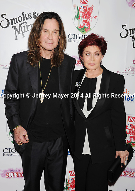 BEVERLY HILLS, CA- SEPTEMBER 13: TV personalities Ozzy Osbourne (L) and Sharon Osbourne attend the Brent Shapiro Foundation for Alcohol and Drug Awareness' annual 'Summer Spectacular Under The Stars' at a private residence on September 13, 2014 in Beverly Hills, California.