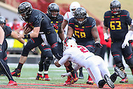 College Park, MD - November 26, 2016: Maryland Terrapins quarterback Perry Hills (11) gets tackled by Rutgers Scarlet Knights defensive back Kiy Hester (2) during game between Rutgers and Maryland at  Capital One Field at Maryland Stadium in College Park, MD.  (Photo by Elliott Brown/Media Images International)