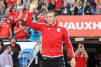 Gareth Bale waves to the supporters as he enters the stadium with the Wales Squad during the homecoming celebrations at the Cardiff City stadium on Friday 8th July 2016 for the Euro 2016 Wales International football squad.<br /> <br /> <br /> Jeff Thomas Photography -  www.jaypics.photoshelter.com - <br /> e-mail swansea1001@hotmail.co.uk -<br /> Mob: 07837 386244 -
