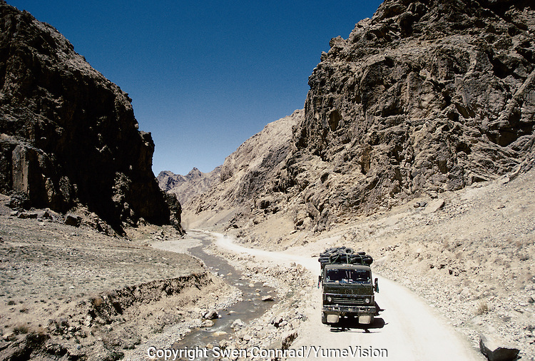 A lorry full of  pneumatic from Russia, on the road to Kabul from Mazar e Sharif via Bamiyan. Hazarajat, Afghanistan.