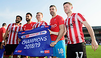 Lincoln City players, from left, Bruno Andrade, Jordan Roberts, Harry Anderson, Matt Gilks and Shay McCartan celebrate after winning the league<br /> <br /> Photographer Chris Vaughan/CameraSport<br /> <br /> The EFL Sky Bet League Two - Lincoln City v Tranmere Rovers - Monday 22nd April 2019 - Sincil Bank - Lincoln<br /> <br /> World Copyright © 2019 CameraSport. All rights reserved. 43 Linden Ave. Countesthorpe. Leicester. England. LE8 5PG - Tel: +44 (0) 116 277 4147 - admin@camerasport.com - www.camerasport.com