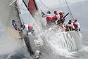 Louis Vuitton Trophy La Maddalena 27 maggio 2010. Siamo al giro di boa. L'equipaggio di Artemis avvolto dagli spruzzi si prepara ad issare lo spi nel corso di una regata con Mascalzone Latino.