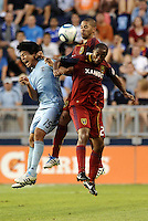 Roger Espinoza (pale blue ) Sporting KC, Alvaro Saborio (centre) Chris Schuler (28) Real Salt Lake go up for  a header... Sporting Kansas City defeated Real Salt Lake 2-0 at LIVESTRONG Sporting Park, Kansas City, Kansas.