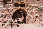 An archway into the theater on the Street of Facades in the Nabataean city of Petra in the Hashemite Kingdom of Jordan.  Petra Archeological Park is a Jordanian National Park and a UNESCO World Heritage Site.