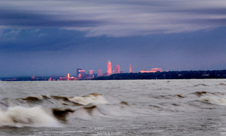 The buildings of the Cleveland skyline catch the last rays of the sun on a late autumn day.